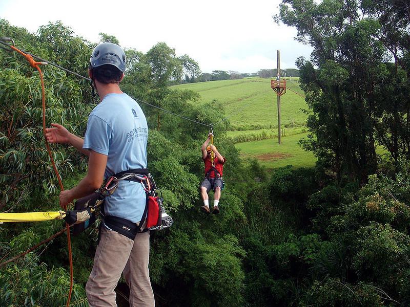 Sam nears the end of his zipline ride. Kauai (Hawaii).