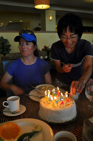 Right after her morning training run and breakfast (Aug. 21, 2009), birthday girl Liz enjoys cake!