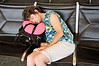 At the Lihue Airport (Kauai), Wendy is trying to bank some sleep time before we head home and lose four hours, due to the time zone.