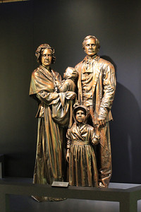 September 22, 2013 - (Abraham Lincoln Birthplace National Historical Park [inside Visitor Center] / Sinking Spring, Hodgenville, LaRue County, Kentucky) -- Statue of Nancy [mother] holding baby Abraham, with Thomas [father] & Sarah [sister]
