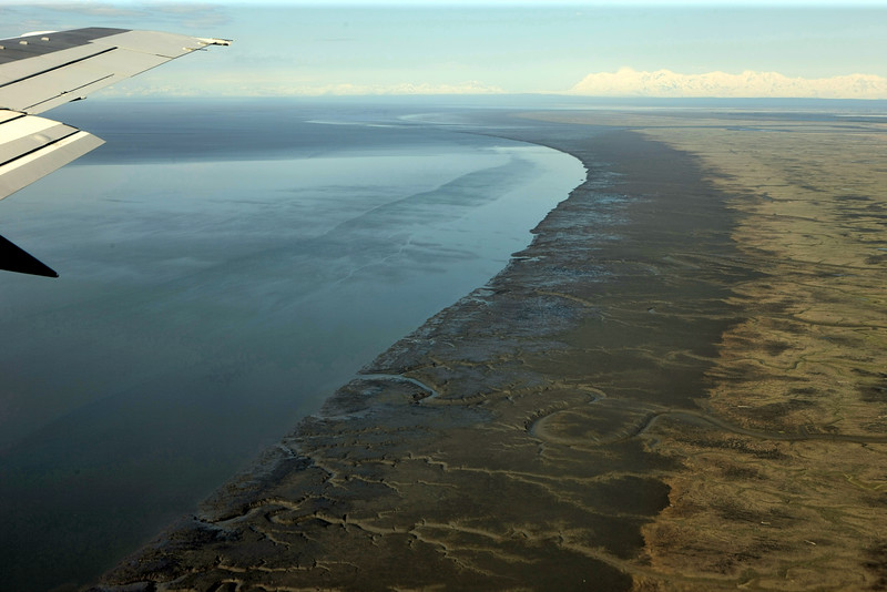 Mudflats, Mt. Spurr across Cook Inlet.  Almost to the runway