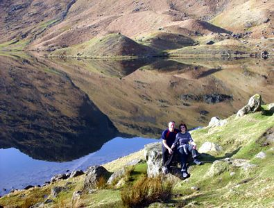 Linda and Steve and reflections in Easedale Tarn.