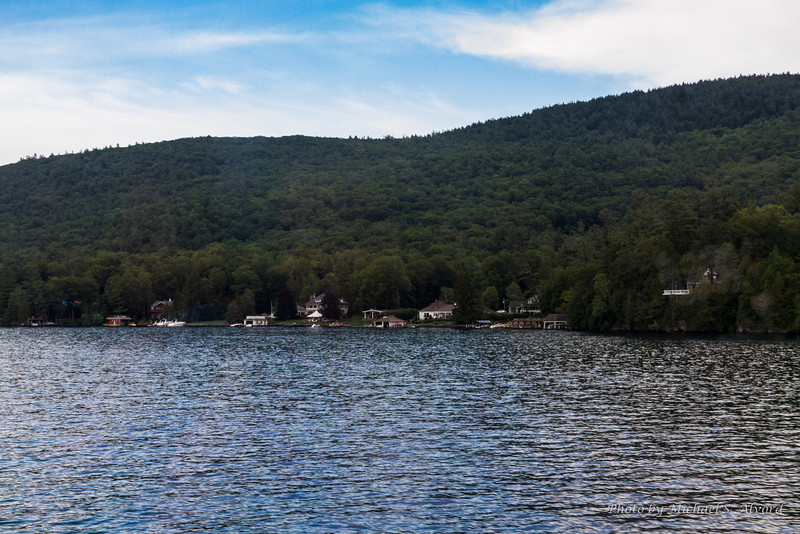 View of the many very nice houses we seen while on our July 4th Dinner Cruise on Lake George.