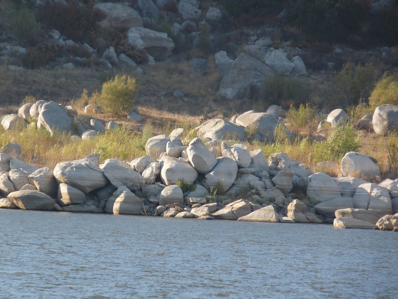 Stripes on rocks across the lake show the relentless drop in the water level.