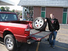 Eric with the tire that blew out on I-494when he and Kessy were coming to join us at Lake Pimushe. July 5, 2006.