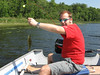 Not quite a keeper. Eric fishing on Lake Pimushe. July 3, 2006.