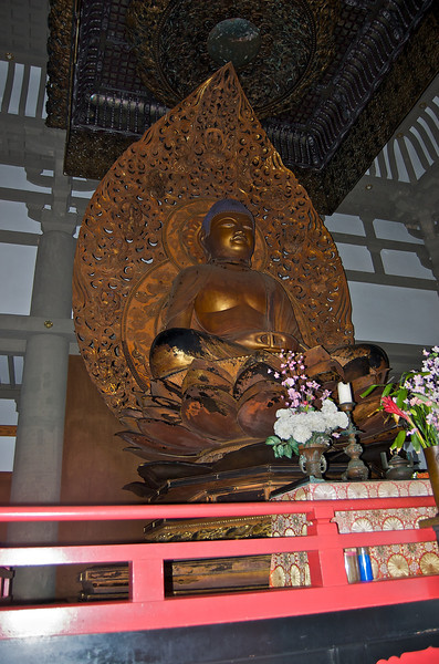The inner temple requires you to remove your shoes before entering to view the buddha.