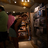 Omi intently studying a might-be-purchase in the ginormous gift shop.