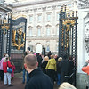 people staring past the bored guard at the gate of Buckingham Palace