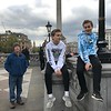 Nick, Alex, and Uncle Bill watching street performers outside Trafalgar Square.