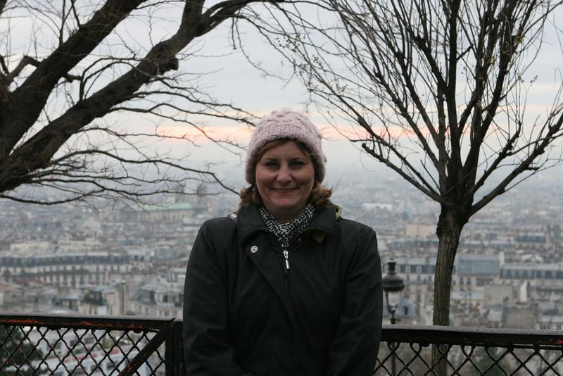 Amy at the the Basilique Sacré-Cœur.  View of city of Paris is behind her.