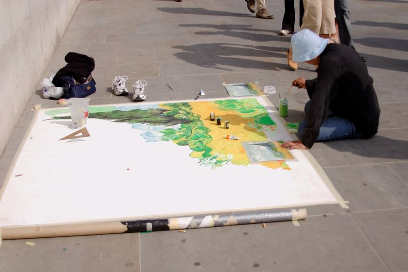 "Outside the National Gallery where ""Wheatfield with Cypresses"" hangs.  This man was making a copy of it."