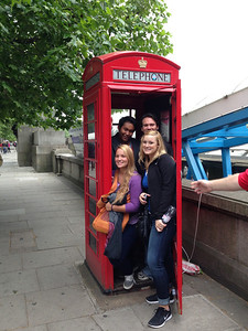 Undergraduate students posing in a London phone booth: Ty and Matt, Maisie and Emily.