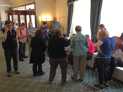 Group meeting  (15 of us) in the lobby at Endsleigh Court. At this first meeting we shared our newly-acquired London phone numbers. Ken was testing his phone.