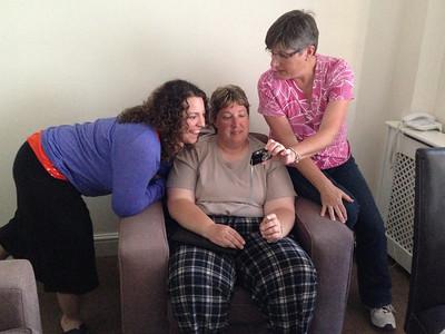 Cassie, Sherri, and Deb sharing photos