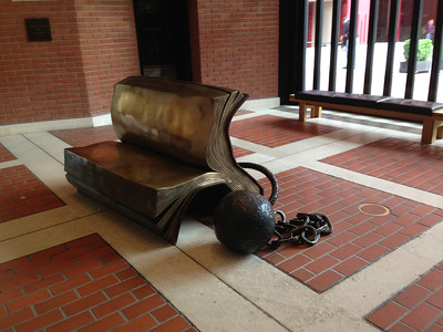 I love this bench in the British Library!  I remember learning in library school years ago that valuable reference books were chained in place in the British Museum library reading room, so I recognized the significance of this design immediately.