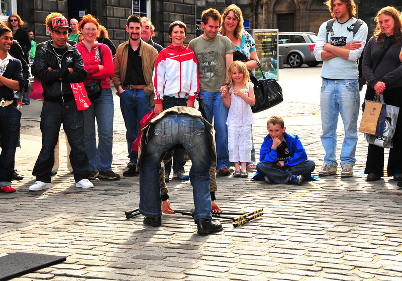 By now, street performers should know better than to bend over like this with their back end facing Skylon.