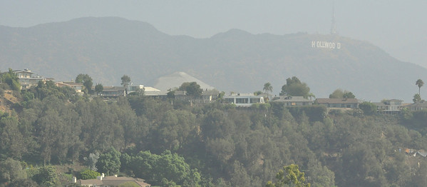 It's so hazy it's hard to see the Hollywood sign, but it 's there...lost ini the haze