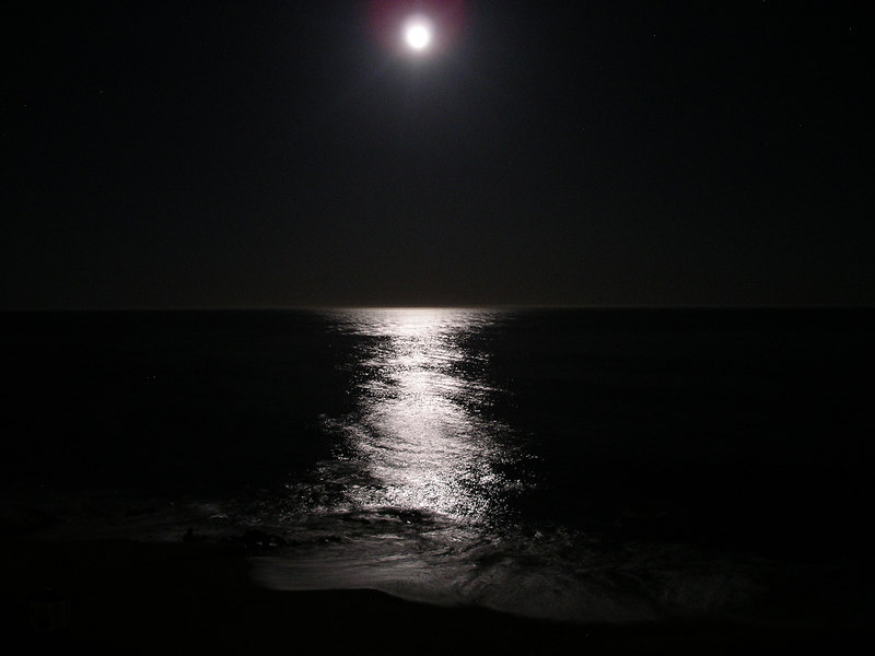 The view of the moon against the ocean from our room balcony.