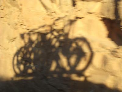 Bike shadows against the slickrock