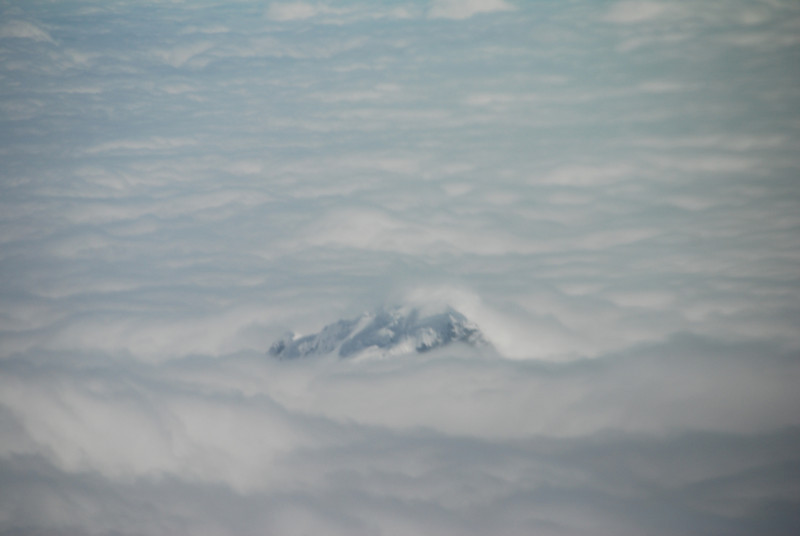 Mountain poking through the clouds.