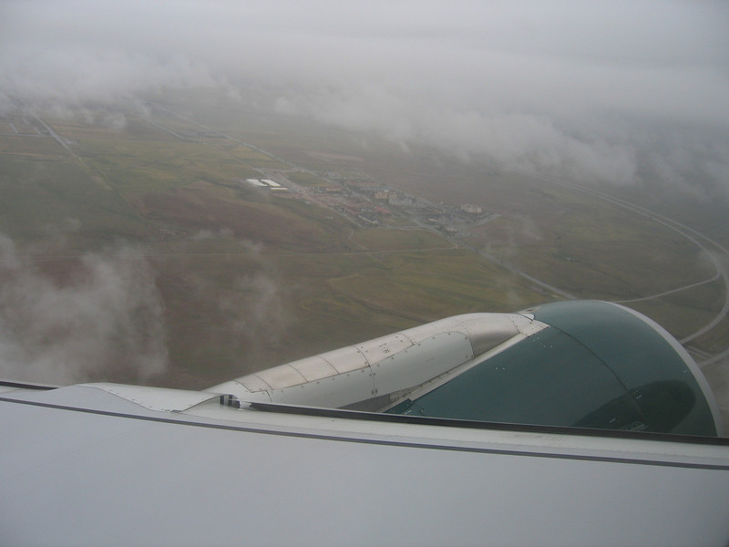 Climb out over DIA in the rain.