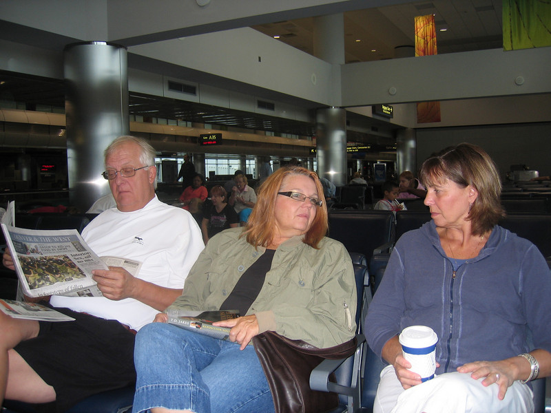 Bob, Donna, and Bonnie relaxing at the airport.