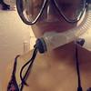 Lisa wearing snorkel in house