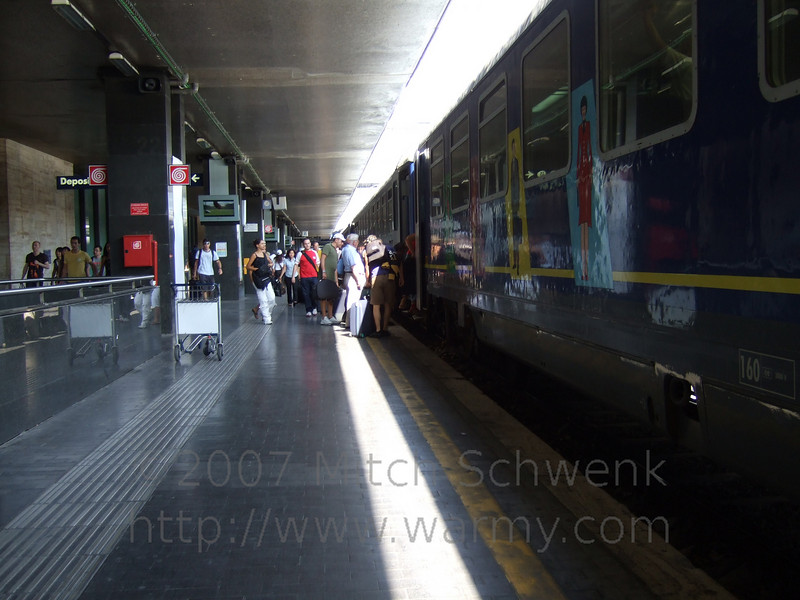 Getting off the train at Central Station, Rome.