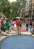 Walking along Las Ramblas in Barcelona, and standing on a mosaic by Joan Miro, a famous painter, sculptor, and ceramicist born in Barcelona.
