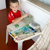 Grandson Evan painting a leaf picture