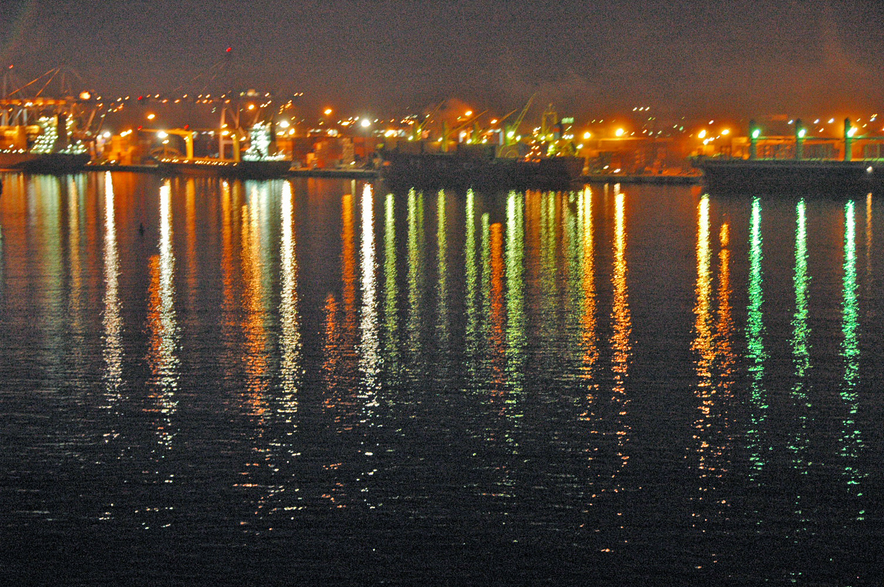 Night shot at Manzanillo harbor (looking east).  It is a major commercial shipping port.