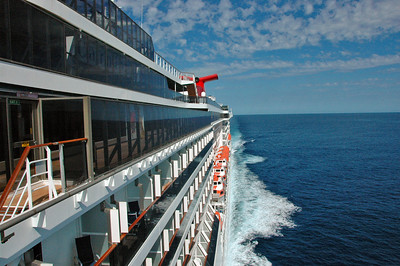 Carnival Spirit.  Had 2,100 passengers and 950 crew on board.  Very large, stable ship with beautiful rooms and common areas. Our rooms were on the second deck from the top with balconies in the above pic. Speed averaged a fairly constant 21-23 knots when at sea.