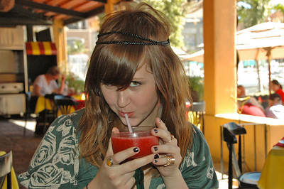 Christina having a margarita in Cabo.