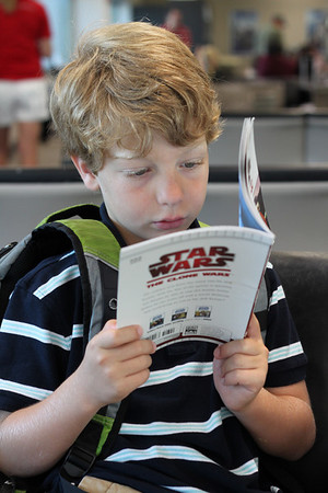 Harry reading his English lit in the airport.