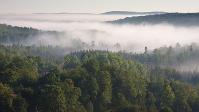 My dinner view at the Otsego resort in Gaylord, MI.  Actually a morning shot that I took before I left from the spot I had dinner the night before.  Beautiful view of norther Michigan forest land.  The golf course I played 'The Tribute' is laid out in the valley coverd by the fog.