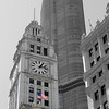 Old and new with the flag hightlighted against the Wrigley building and Trump Tower.