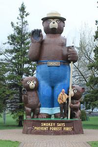 "May 19, 2013 - (""Smokey the Bear"" Park / International Falls, Koochiching County, Minnesota) -- David on ""Smokey the Bear"" statue [*note that even the bear cubs are larger than David]"