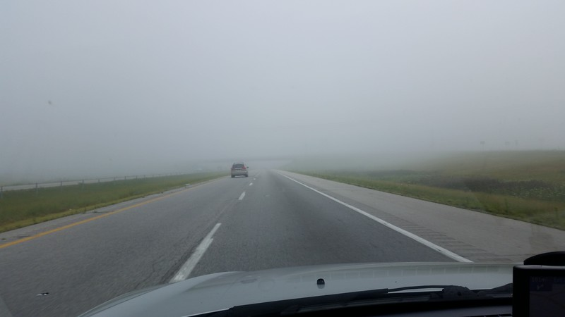 Driving in Indiana very early on a Sunday morning.  It was so foggy I didn't even see all the windmills at first.  Don't worry, there was no traffic, so I snapped a quick picture.  I don't stay on my phone at all when driving.  ;)
