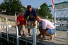 Bryce, Travis Bisenius and Phil on the boat dock