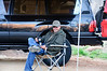 Bob - relaxing at camp with his flask of coffee.  He's Expo Approved™ with his Overland hat on.