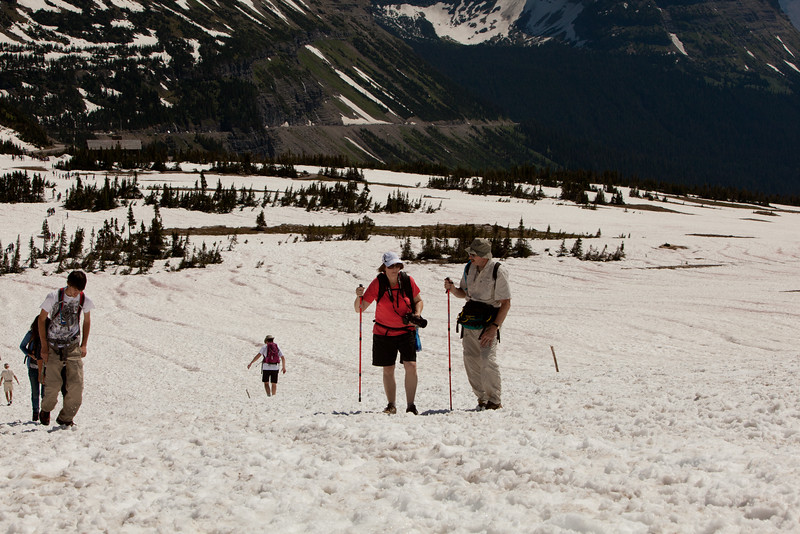 Sue and Len hiking at Logan Pass. Still lots of snow, makes it like walking in sand.