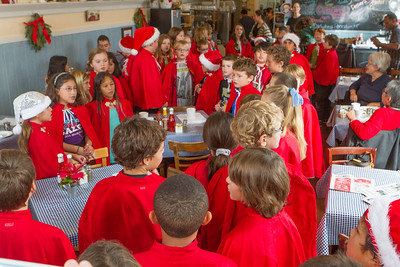 A suggestion from the PG visitors center for breakfast was Holly's Lighthouse Cafe.  As we were driving down the main street nearing the Cafe, we saw a large group of kids - all in red - walking down the sidewalk toward the Cafe.  As we parked and came closer we found they were inside, serenading those inside with Christmas carols.