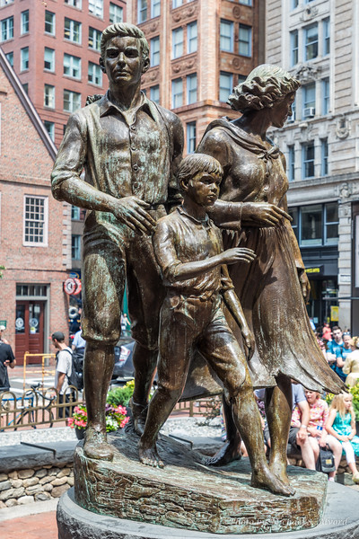 These two statues represent the Irish who came over and reached a better life.
