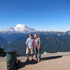 The wife and I are on the summit overlooking Rainier. Rainier national part is on the other side of the mountain.