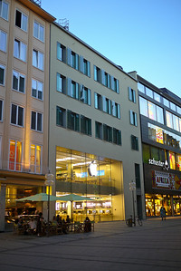 Apple Store in Munich - check out the cool glass shutters on the windows above it.