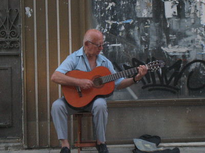 Right outside our hotel on Vronos Street in the Plaka, Athens. This man had lived in Chicago years ago, playing music there.