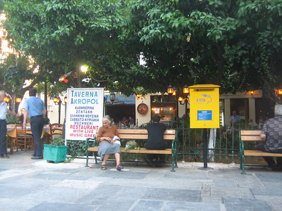 Public park in the square provides seating and free listening for people who wish to listen to the live music at Taverna Akropol.