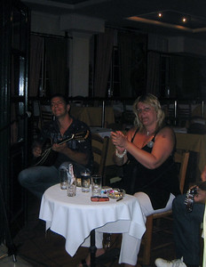 Polly, the singer, does not speak English, but appreciated our attention and interest in her music. The bouzouki player  does speak English. We told them that a friend in America had recommended their music, so we came to find them.