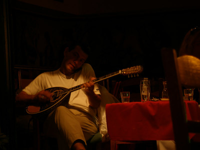 Later at night, after the dancers had stopped,  and few people were in the restaurant, the bouzouki player answered his cell phone and then played while he talked!  He continued doing BOTH for a long time. He played very well, in spite of cell phone.
